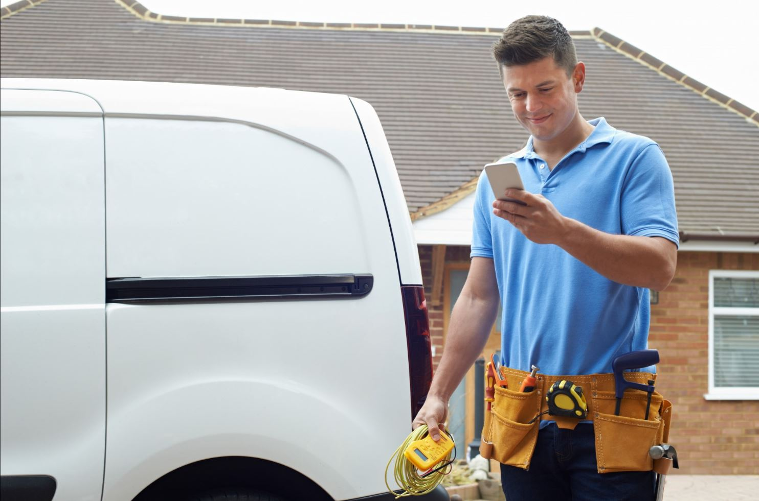 Tradesman looking at his mobile app task tracker